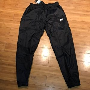 Brand new men's Nike track pants